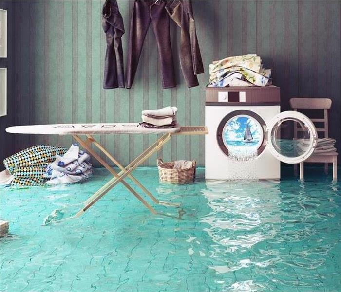 Washing machine overflow into laundry room. Laundry room flooded with water.